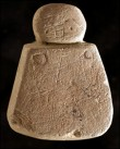 Neolithic carving raises eyebrows